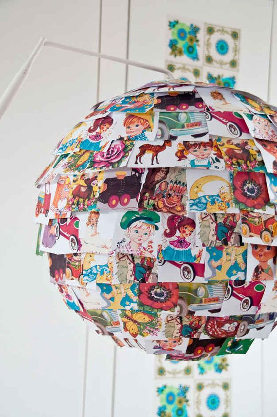 an IKEA Rgolit lampshade personalized with colorful vintage picture books is a veyr whimsical hack