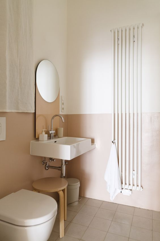 color blocking in the bathroom is a good idea, blush and white is a chic and soothing way to go