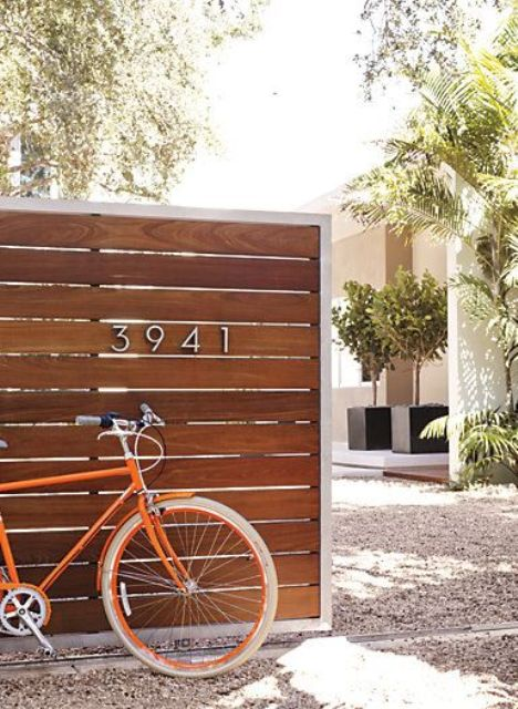 place the house numbers on the fence that is hiding your home and outdoor space from neighbors' eyes