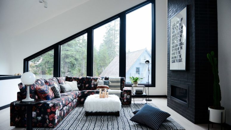 This is a cozy attic space with graphic touches and much light coming from outside