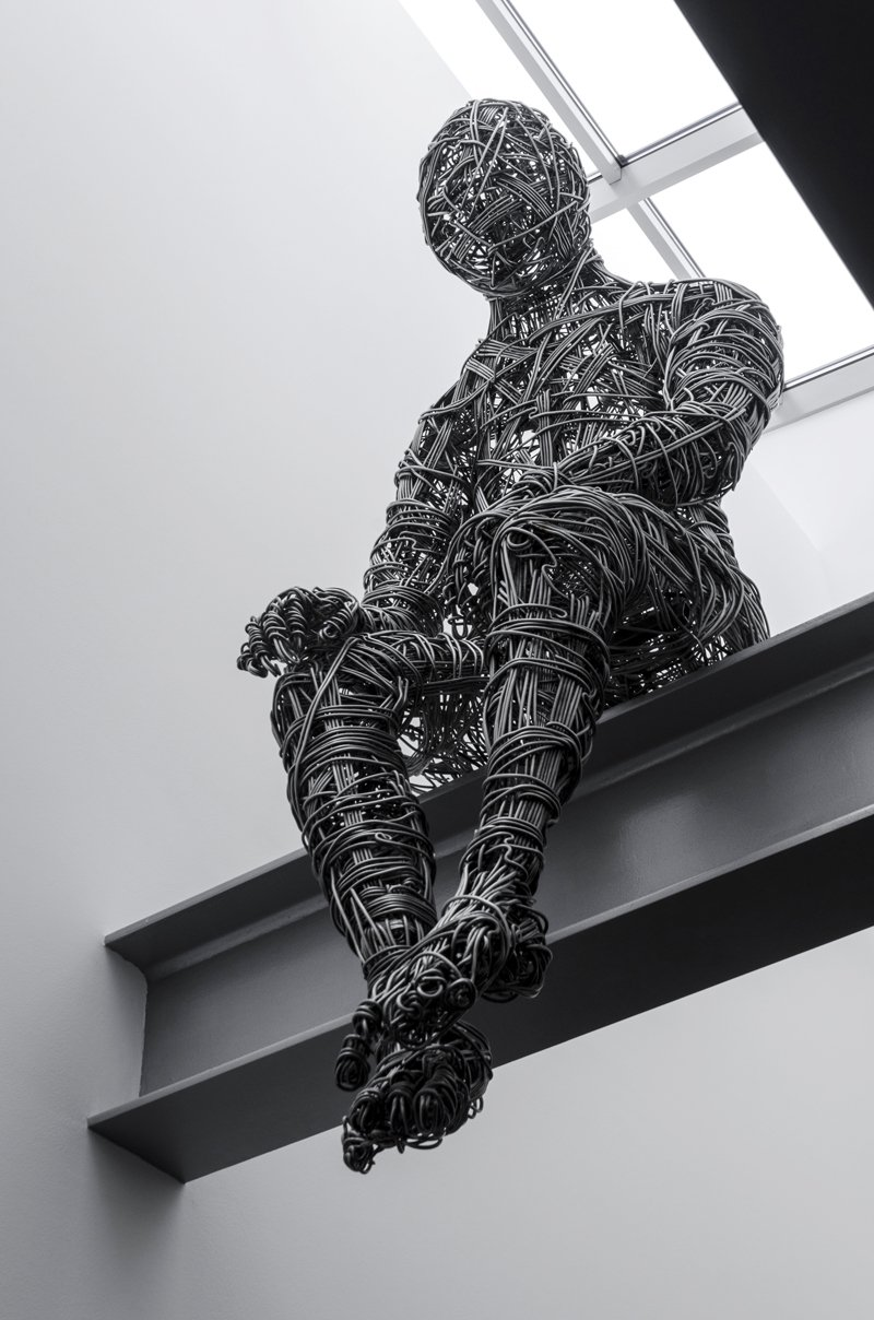 This sculpture is sitting over the living room on a metal beam