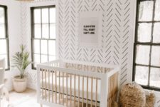 04 a gender-neutral minimal boho nursery with a printed statement wall that looks bold