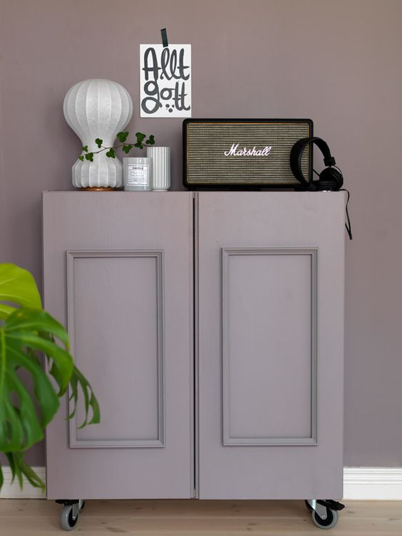 IKEA Ivar cabinet done with paneling, painted dusty lilac and placed on casters for a vintage feel