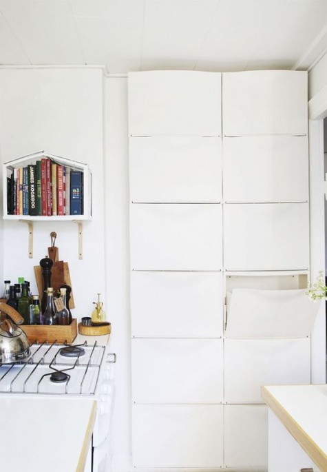 IKEA Trones shelves are a great storage idea to rock in a small kitchen - they are tall enough and can accommodate a lot of things