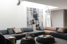 a living room that features a super large sectional sofa