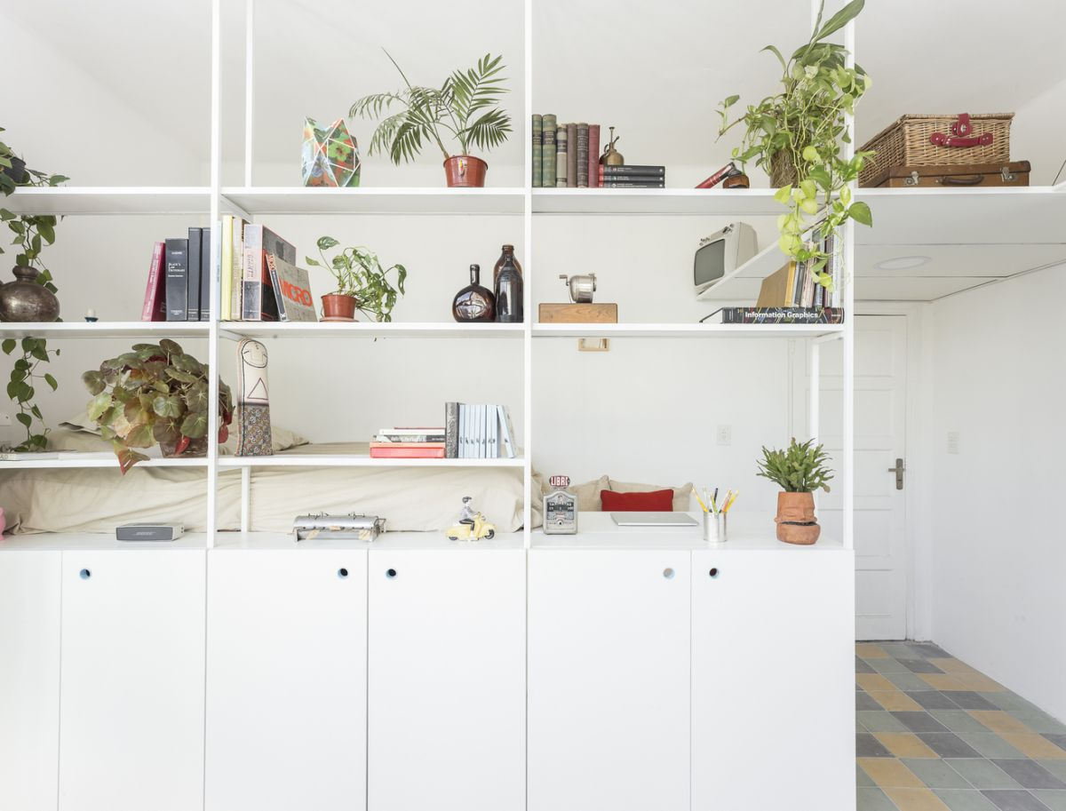 The shelves are airy and ethereal, yet they separate the sleeping and living zone