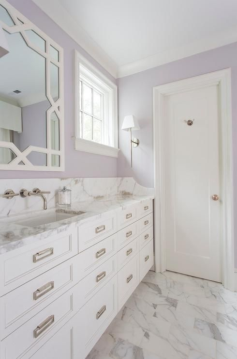 a white and lavender bathroom is a soft and calming space with a slight vintage feel