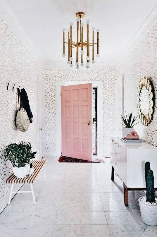 a whole entryway done with whisy spotted wallpaper is a very fun and playful idea