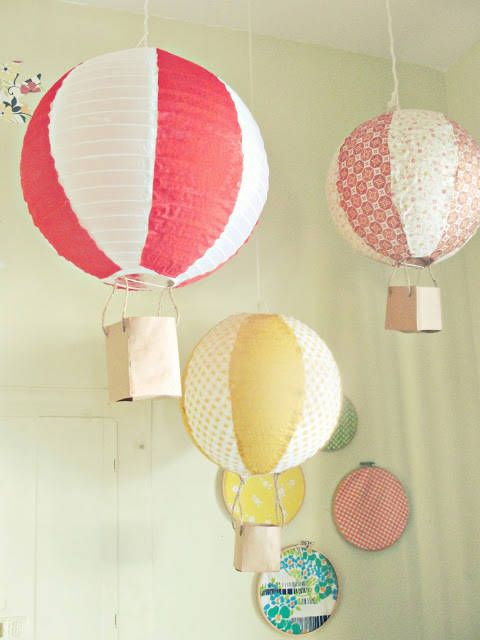 an arrangement of hanging lamps   colorful hot air balloons made of IKEA Regolit lampshades