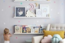 05 spruce up a wall with colorful decals that match the nursery's accessories in color