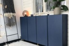06 IKEA Ivar cabinets painted navy and with gold legs look chic and elegant, with a modern twist