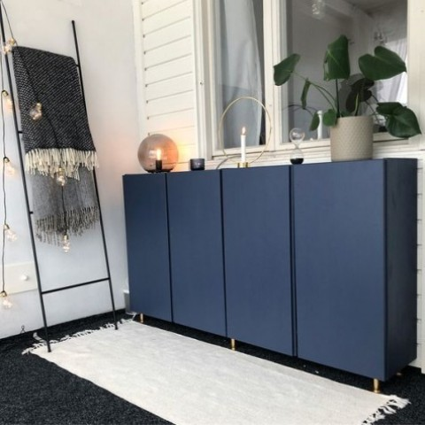 IKEA Ivar cabinets painted navy and with gold legs look chic and elegant, with a modern twist