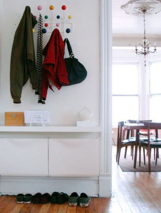 IKEA Trones storage boxes and a tabletop attached over them for a minimalist entryway