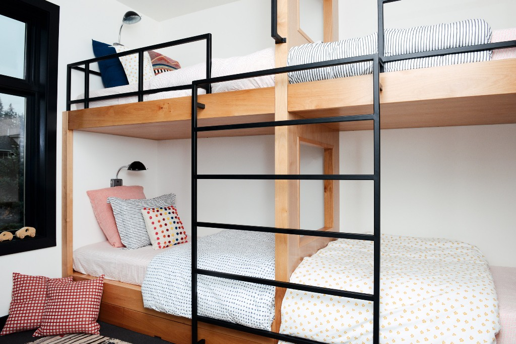 The kids' room features a bunk bed with lots of colorful pillows