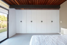 06 The master bedroom is very laconic, it's done in white with a large bed, some cabinets and bedside tables