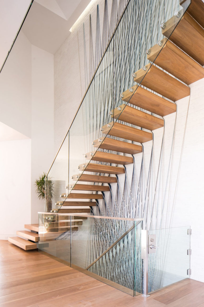 The staircase is a modern floating one