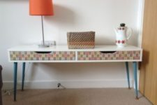 06 a colorful Ekby Alex shelf hack with blue legs and decoupage drawers will fit any mid-century modern space