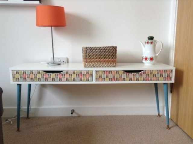a colorful Ekby Alex shelf hack with blue legs and decoupage drawers will fit any mid century modern space