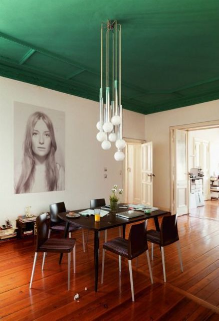 a dining space with a grass green emerald ceiling is a bold color statement that sets the tone