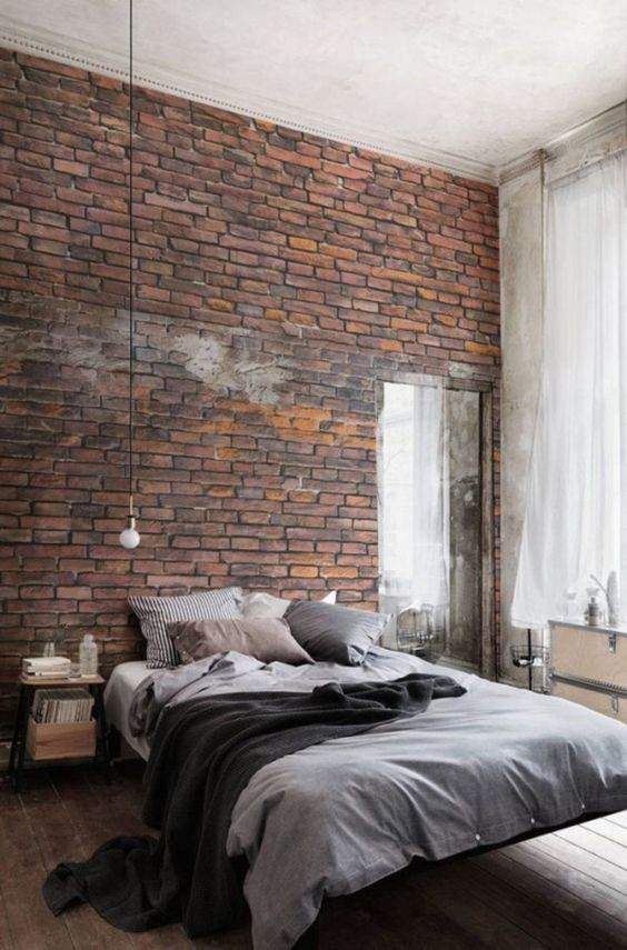a gorgeous brick statement wall is an amazing idea for a masculine or an industrial bedroom