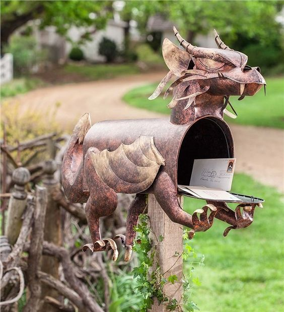 a metal dragon mailbox is a gorgeous idea for geeks, fantasty fans and many others   it won't be unnoticed