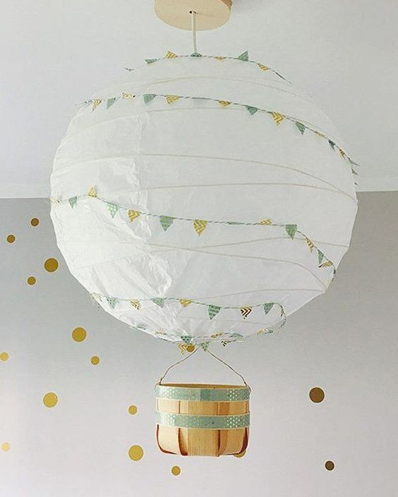 an IKEA Regolit lampshade with colorful bunting and a little basket makes up a gorgeous hot air balloon lamp