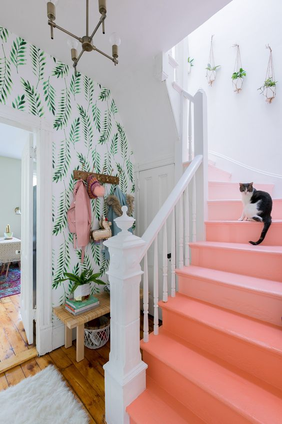 botanical prints never go out of style, and an ombre coral staircase features the color of 2019