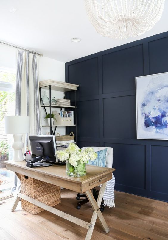 navy paneling is a statement idea thanks to its color and it brings texture to the space