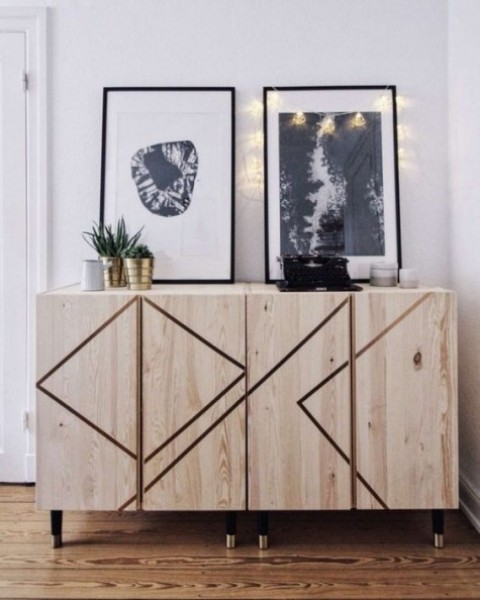Ivar cabinets decorated with geometric patterns made with masking tape and black and gold legs