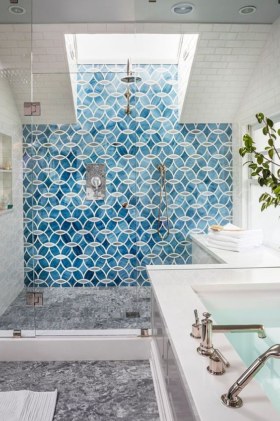 a bold blue mosaic tile statement wall in the shower is a bold idea to add color and pattern to the bathroom