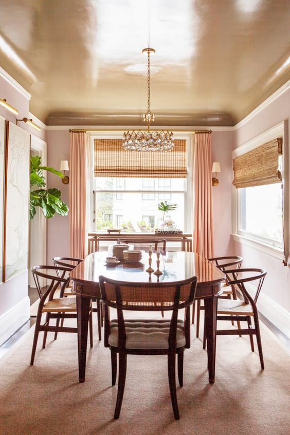 a copper dining room ceiling keeps the space warm-colored and peachy while adding a shiny touch to it