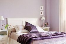 07 a feminine bedroom with lilac walls, purple accessories and an upholstered bench is a chic and refined idea