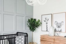 07 a pale blue paneled statement wall subtly adds color and makes the space catchy and interesting