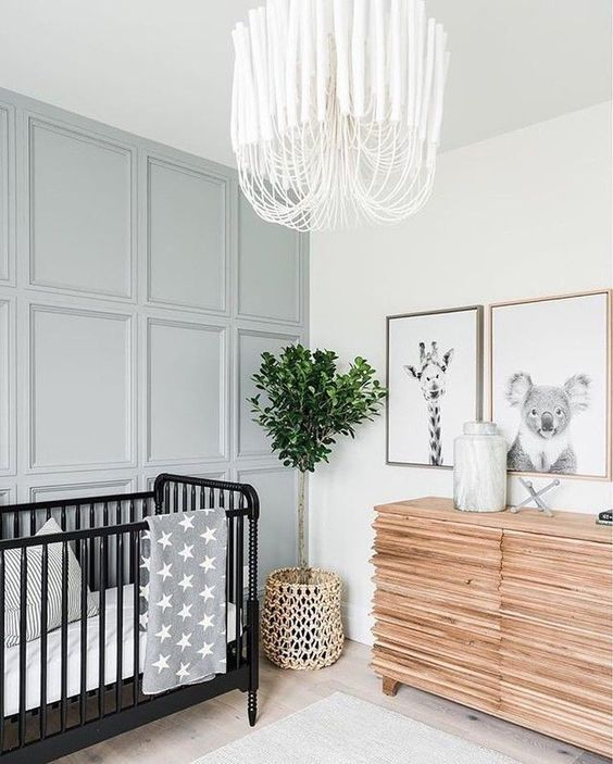 a pale blue paneled statement wall subtly adds color and makes the space catchy and interesting