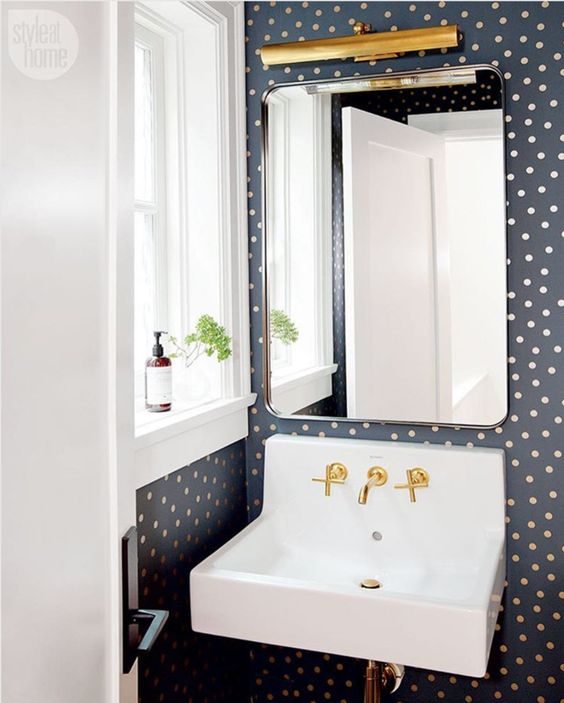 cute polka dot wallpaper will easily spruce up your bathroom or powder room