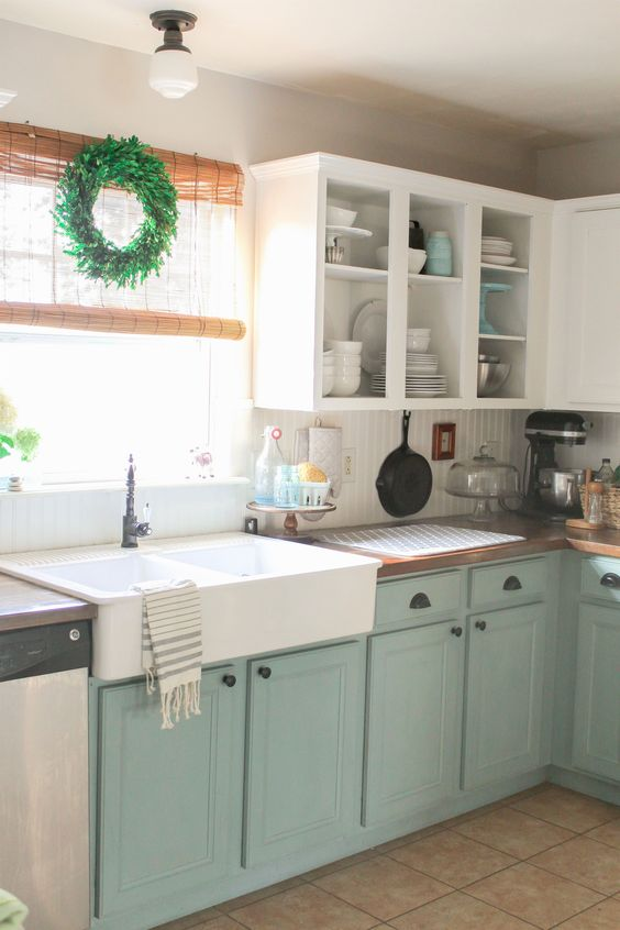 mint and white kitchen cabinet make up a relaxed space with a vintage feel