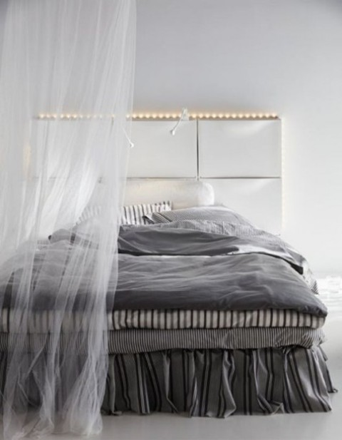 use IKEA Trones to create a comfy headboard with storage and lights, ideal for a contemporary space