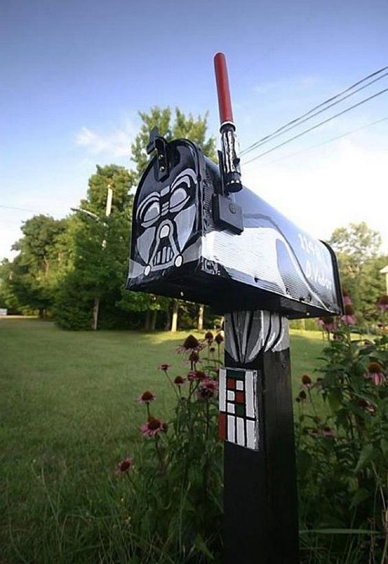 Darth Vader inspired mailbox with a lightsaber is a fantastic mailbox idea for a geek   so enjoyable