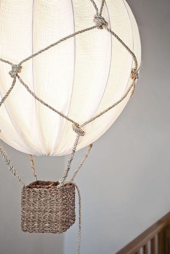 a beautiful hot air balloon lamp using rope and an IKEA Regolit lampshade is a gorgeous and dreamy DIY