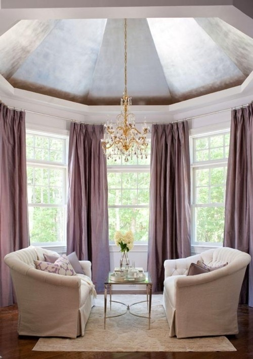 a cozy awkward nook with a domed ceiling and a skylight plus metallic cover on the ceiling