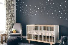a dark celestial statement wall is a gorgeous modern idea for any nursery, looks so cute