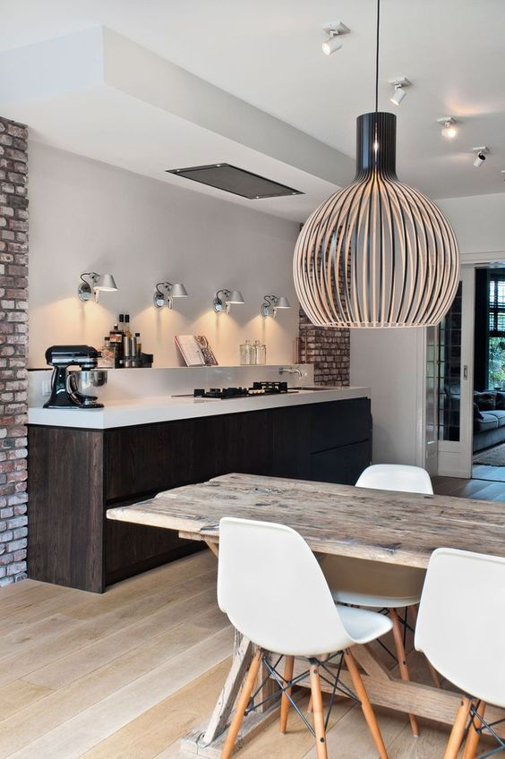 a dark stained kitchen island is a dominant piece in the whole space, it makes a statement