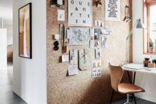 a cork wall is a statement solution that you can use to hang photos on