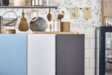 08 floating IKEA Ivar cabinets to comprise a kitchen, each door painted a different color