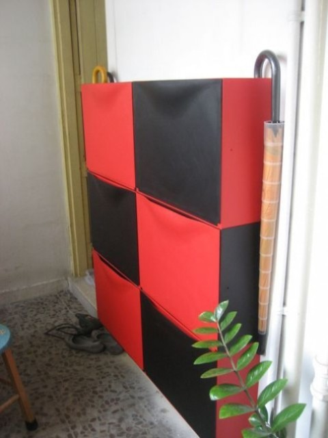 a colorful IKEA Trones hack in red and black will make a bright statement in your entryway