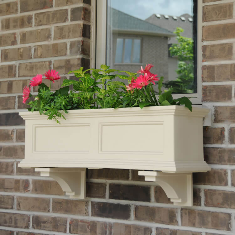 a cream-colored molding flower box with pink flowers is a traditional idea to go for