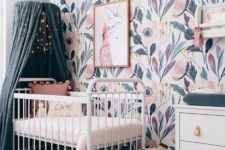 an awesome girl's nursery design with a canopy bed