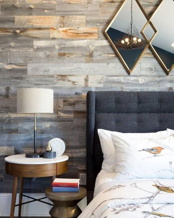 a weathered wood statement wall is a great way to add texture and coziness to the bedroom