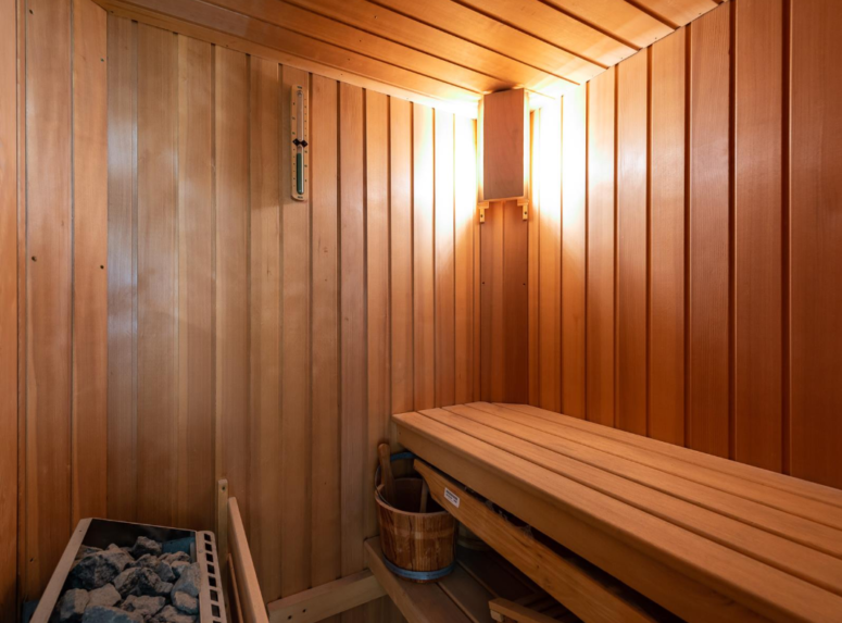 The bathroom includes a sauna for full relaxation