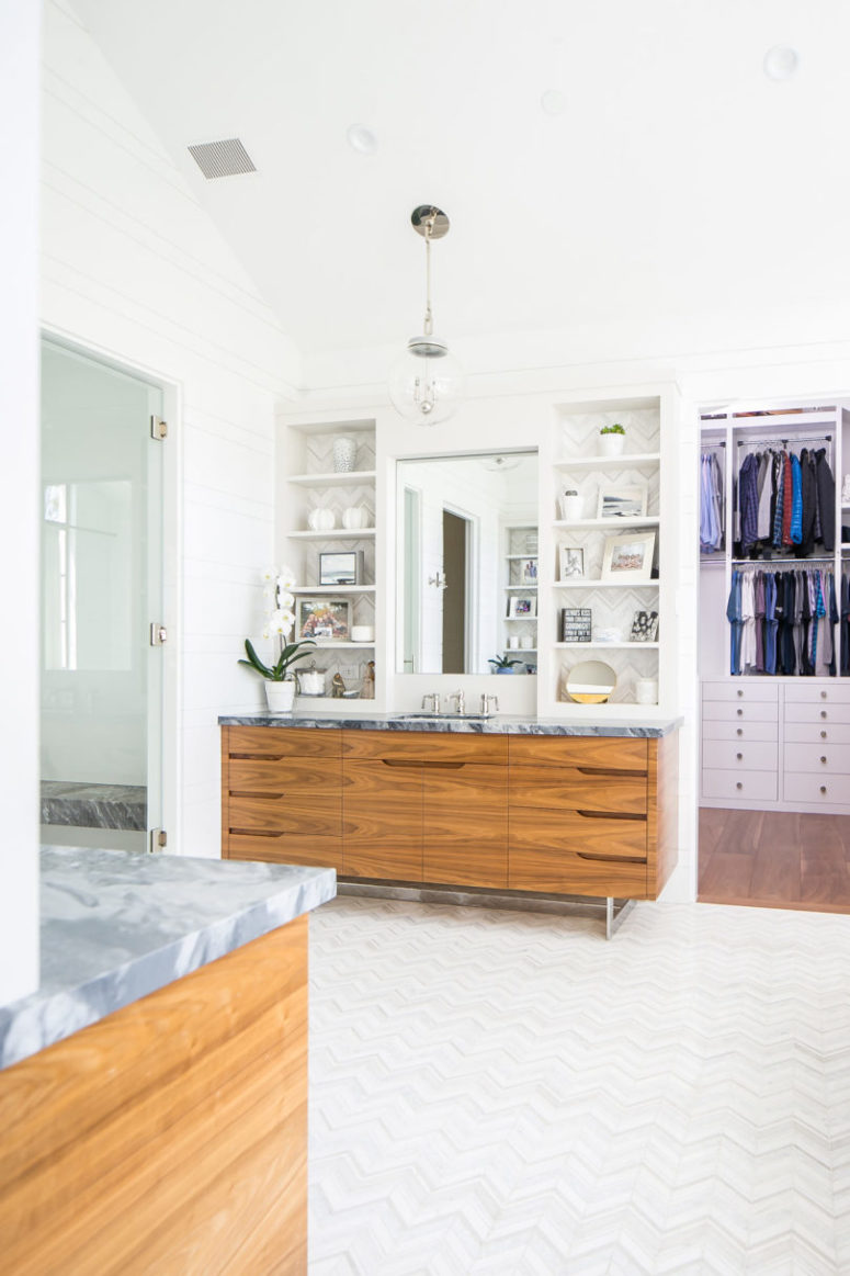 The master bathroom is neutral, with marble countertops
